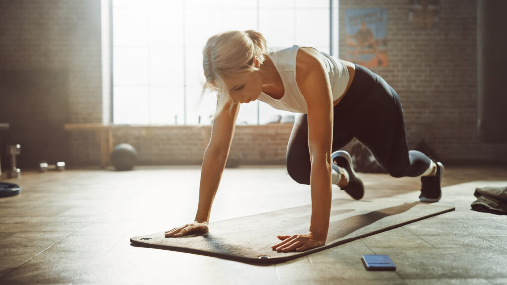 Woman Doing Running Plank Exercise